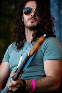 Photograph. The guitarist. the Katy Hurt Band