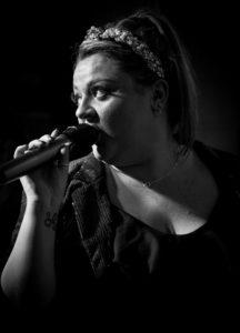 Image live music event. Female singer